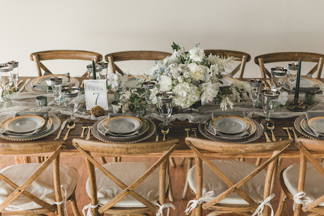 Farm table indoor wedding reception with a muted color palette | About Time Photography