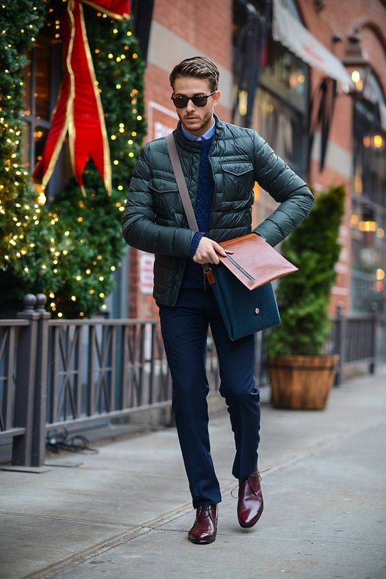 navy trousers, a navy pullover and rich brown shoes