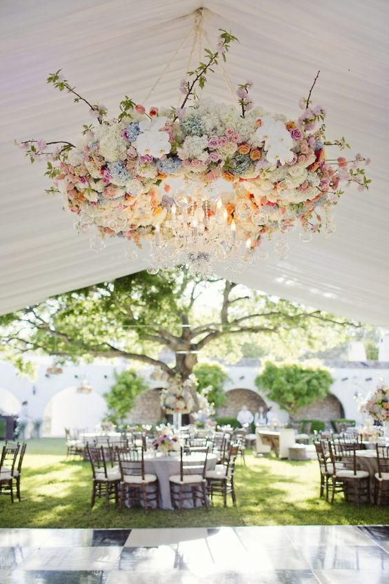 beautiful floral chandelier in pastel shades with crystal pendants for a spring wedding