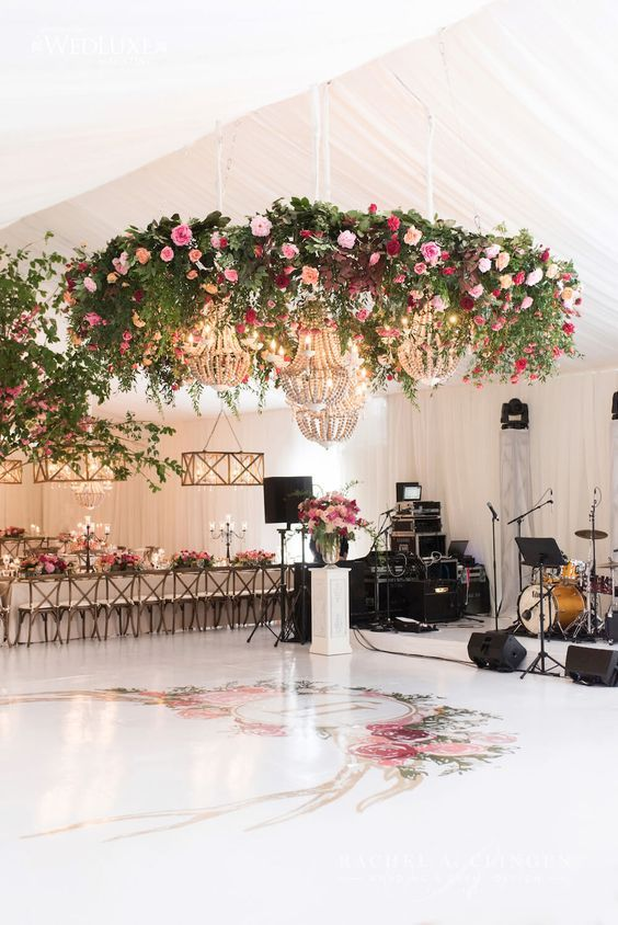 bold flower chandeliers with usual crystal ones for accentuating a dance floor