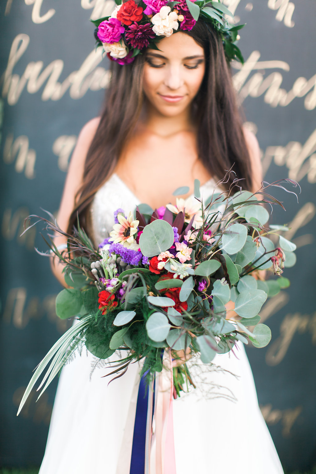 wild bouquet with eucalyptus - photo by Elizabeth Marie Photos http://ruffledblog.com/gold-and-plum-wedding-inspiration-with-hayley-paige-gown