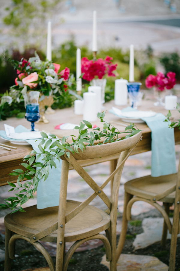 The wedding tablescape was a fine art one, with colorful dishes, glasses and greenery