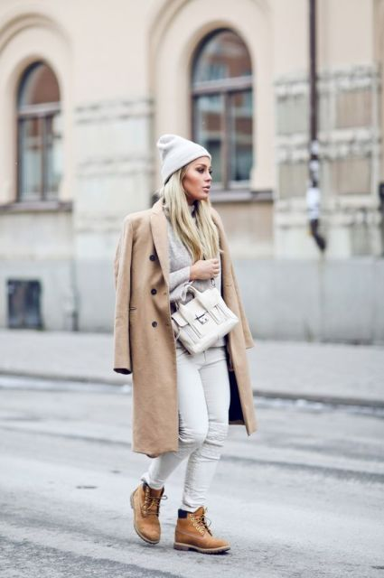 With midi neutral coat, white pants and beanie