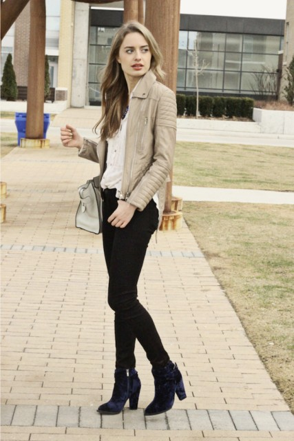 With neutral color leather jacket, skinny black pants and white shirt