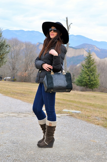 With puffer jacket, jeans and wide brim hat