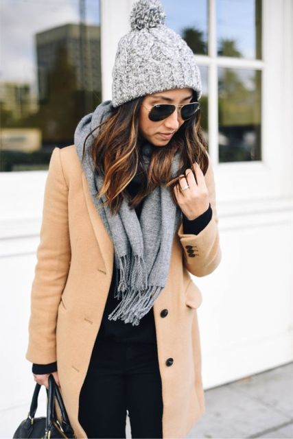 With camel coat and gray scarf