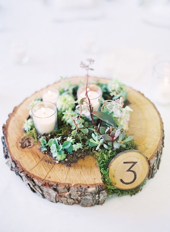 wood slice with moss and flowers, a small table number
