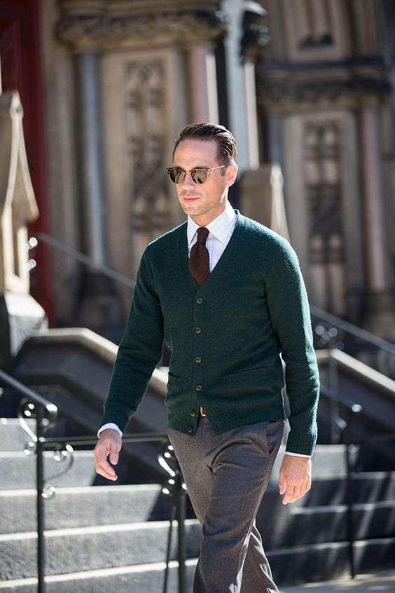 green cardigan, grey trousers, a brown tie