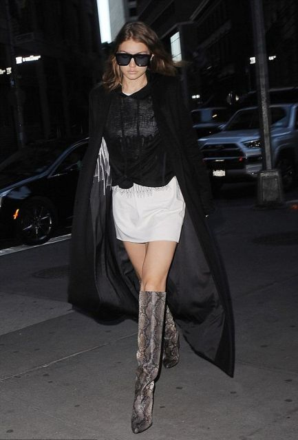 With white mini skirt, black blouse and maxi coat