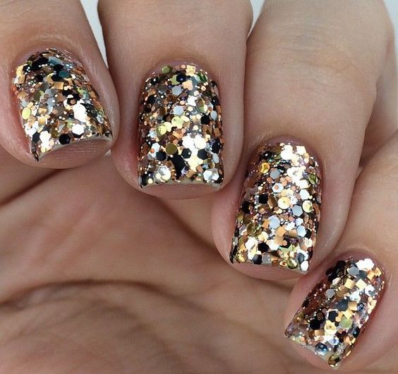 holiday manicure with large gold sequins