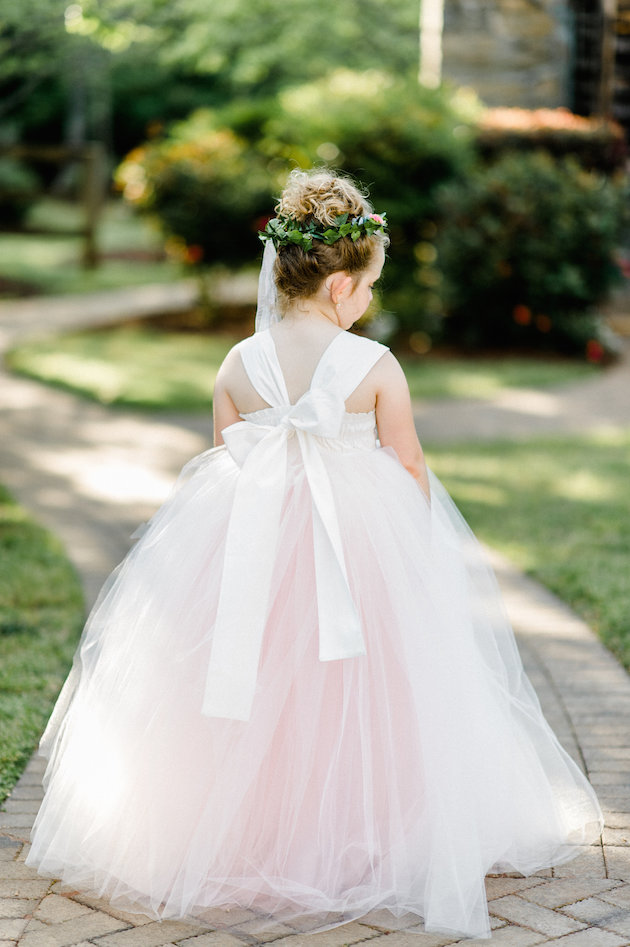 The flower girl in a rose quartz dress and a greenery crown looked like a little angle