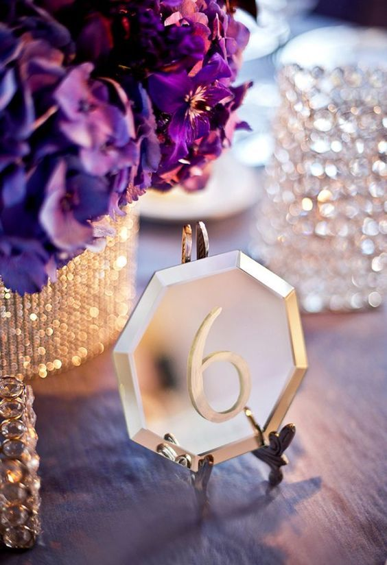 mirrors are popular for wedding decor and such table numbers can be DIYed