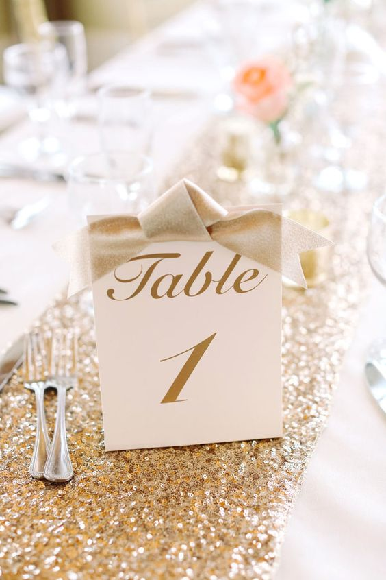 gold calligraphy table numbers with bows