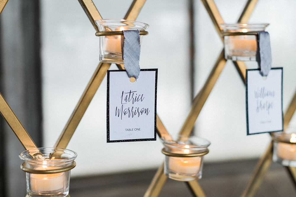 candle seating cards - photo by Alexis June Weddings http://ruffledblog.com/industrial-glam-wedding-inspiration