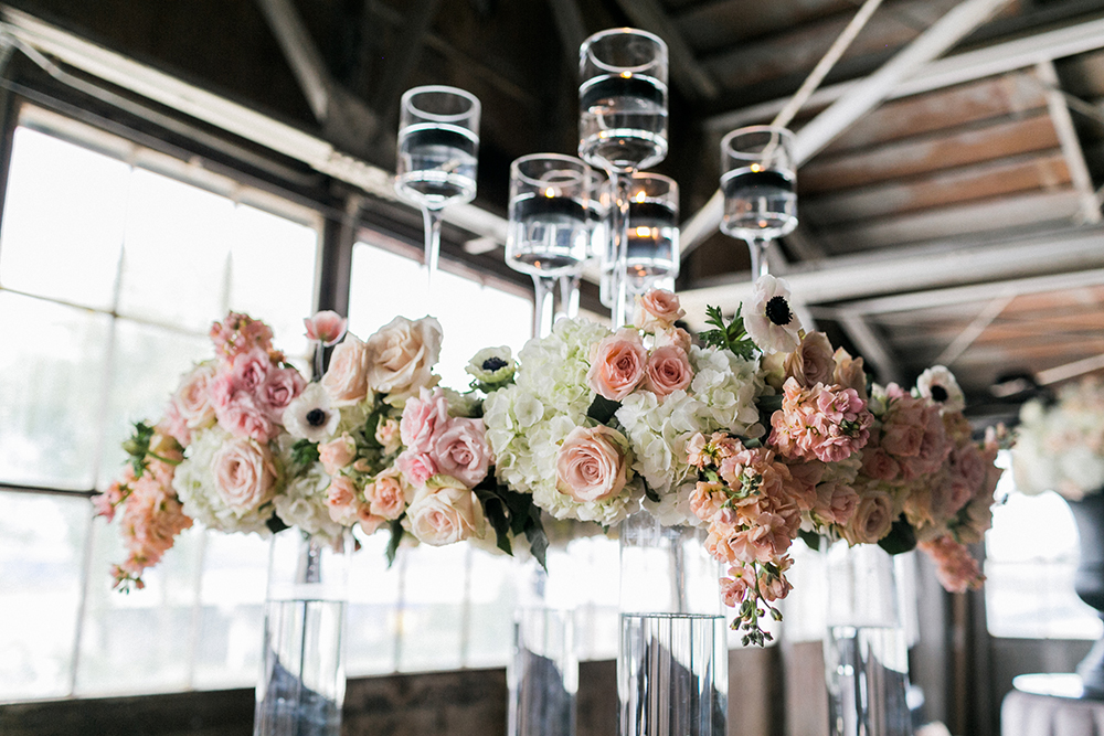 tall centerpieces - photo by Alexis June Weddings http://ruffledblog.com/industrial-glam-wedding-inspiration