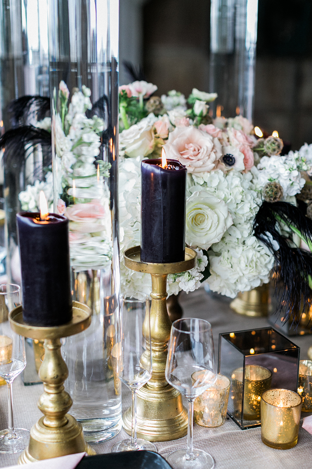 black candles - photo by Alexis June Weddings http://ruffledblog.com/industrial-glam-wedding-inspiration