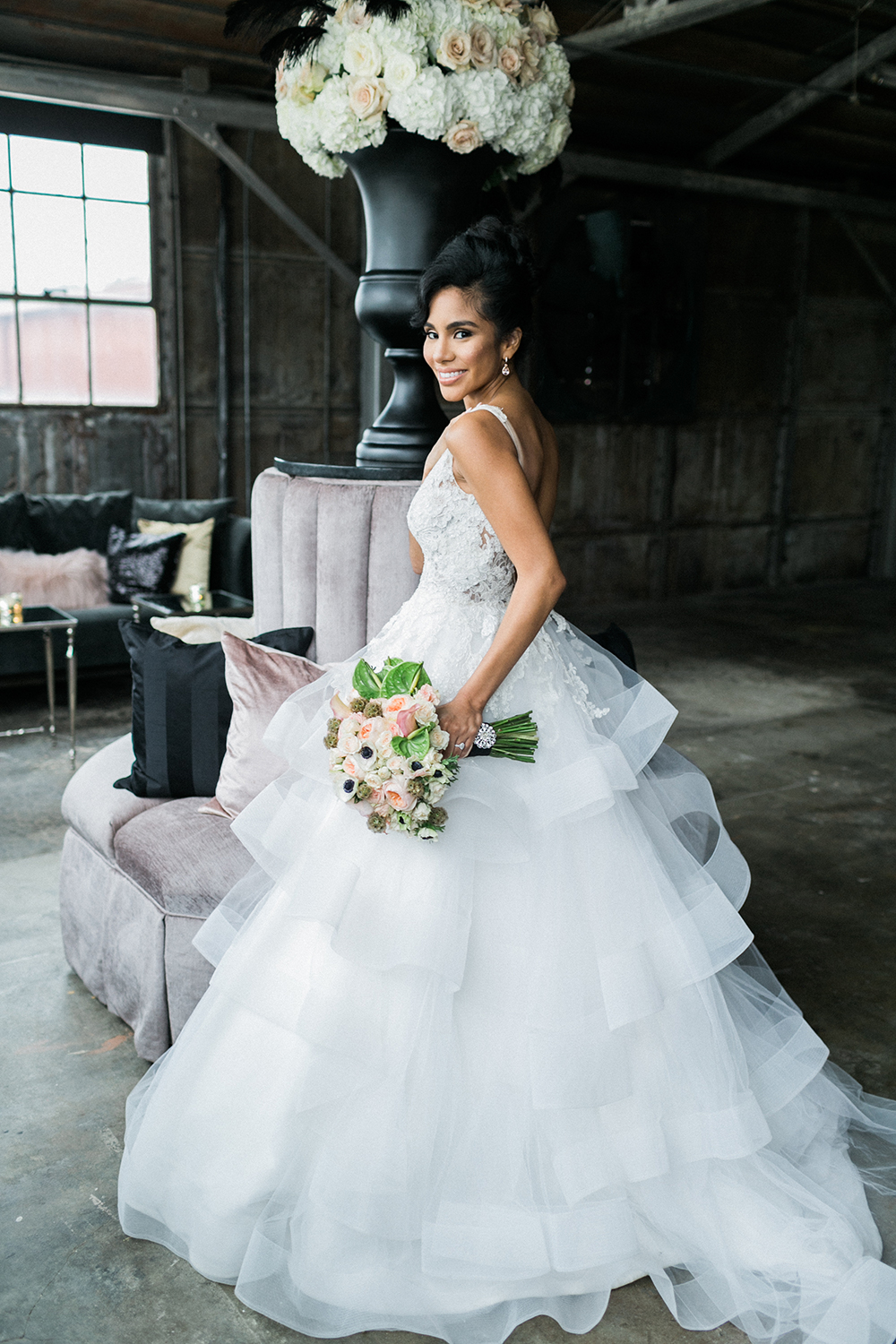 layered wedding dress - photo by Alexis June Weddings http://ruffledblog.com/industrial-glam-wedding-inspiration