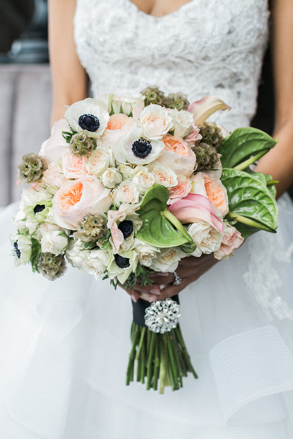 peach bouquet with white anemone - photo by Alexis June Weddings http://ruffledblog.com/industrial-glam-wedding-inspiration
