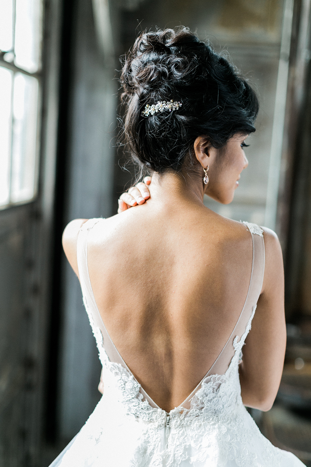 wedding dress back - photo by Alexis June Weddings http://ruffledblog.com/industrial-glam-wedding-inspiration