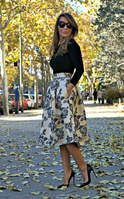 With simple black shirt and classic pumps