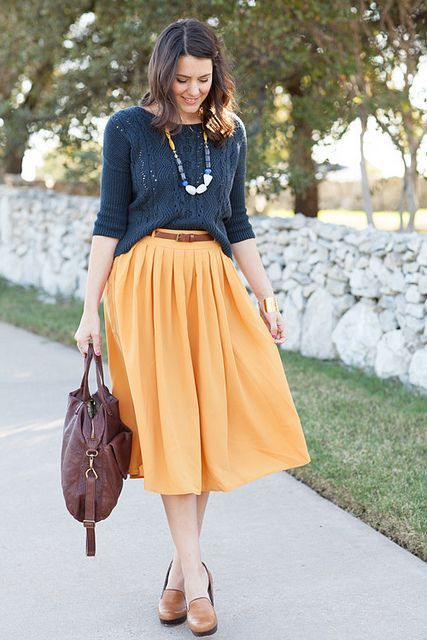 yellow pleated midi skirt, a dark grey sweater and flats