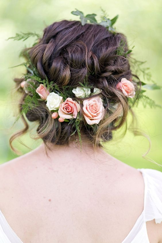 messy braided updo with fresh roses