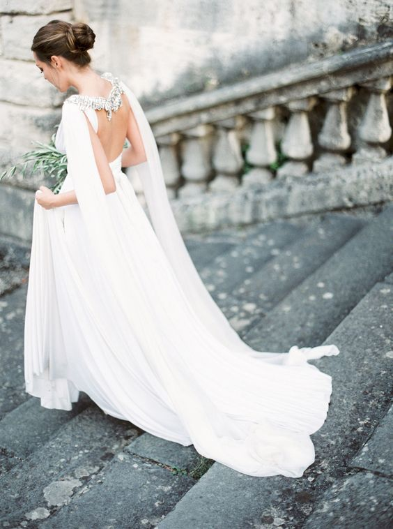 elegant wedding gown with embellished cape