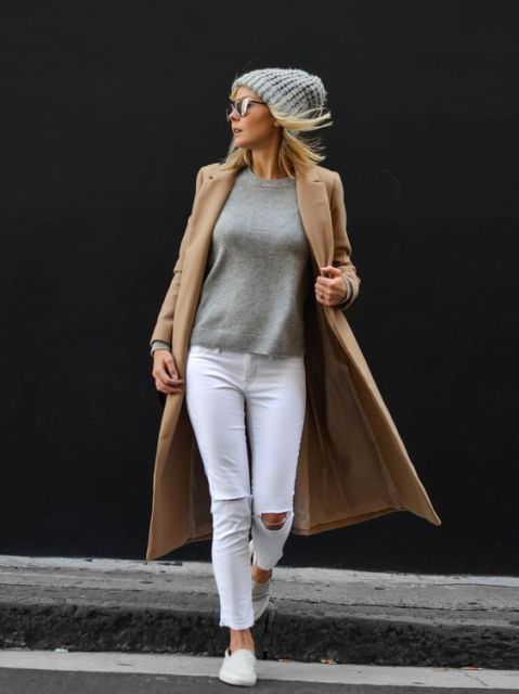 With gray sweatshirt, white jeans and camel midi coat
