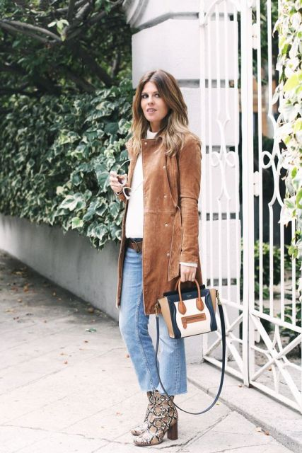 With white shirt, crop jeans, knee-length suede coat and mini bag