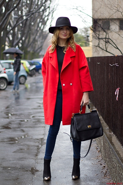With black blouse, skinny jeans, ankle boots and wide brim hat