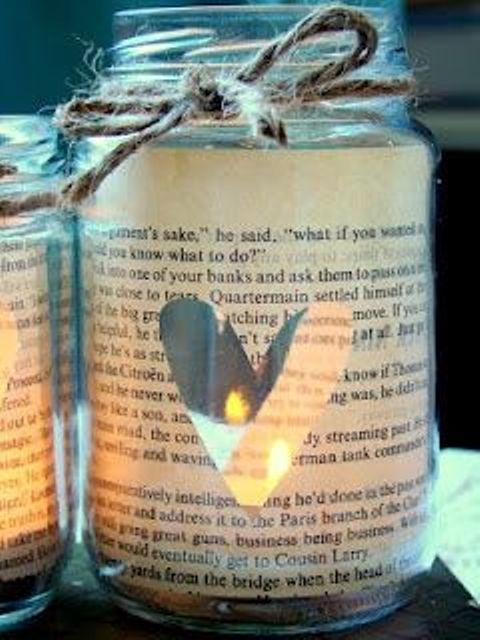 mason jars wrapped with book pages and with cutout hearts are amazing lanterns