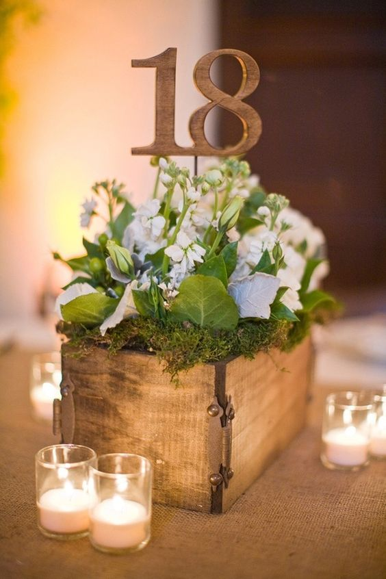wooden box with moss and flowers, wooden table numbers on sticks