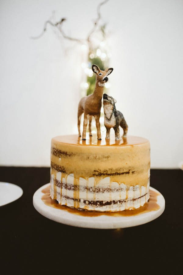 The cake toppers were inspired by the groom