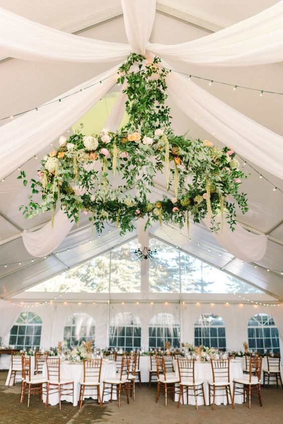 giant greenery and flower chandelier to accentuate the reception space