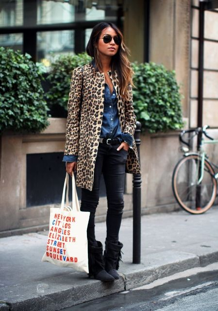 With denim shirt, black pants and leopard coat