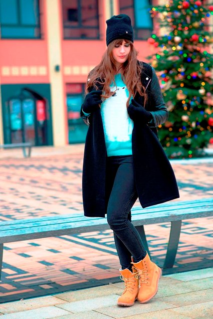 With sweatshirt jeans and puffer coat