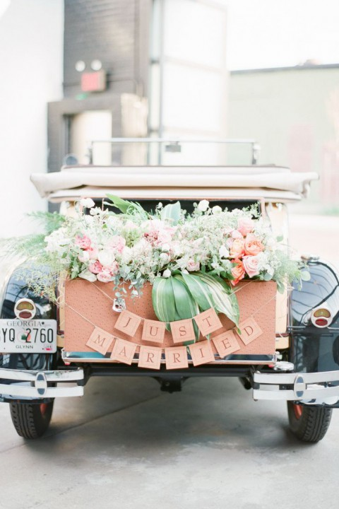 peach colored car decor with greenery and peach flowers