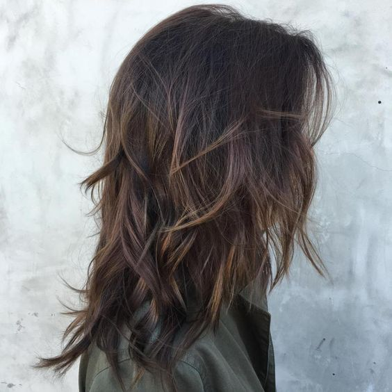 dark chocolate brown hair with light balayage for volume