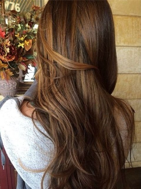 chestnut brown hair with golden balayage highlights