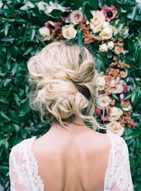 romantic tousled updo looks cool on hair with lowlights