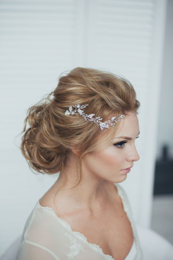 messy updo with a crystal tiara