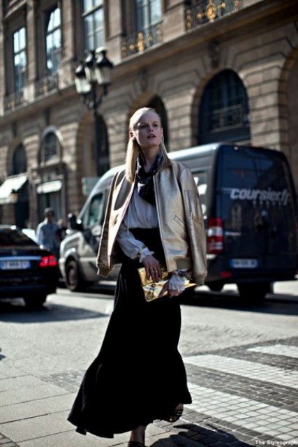With maxi skirt, white blouse and metallic clutch