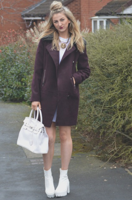 With white shirt, mini skirt and purple coat