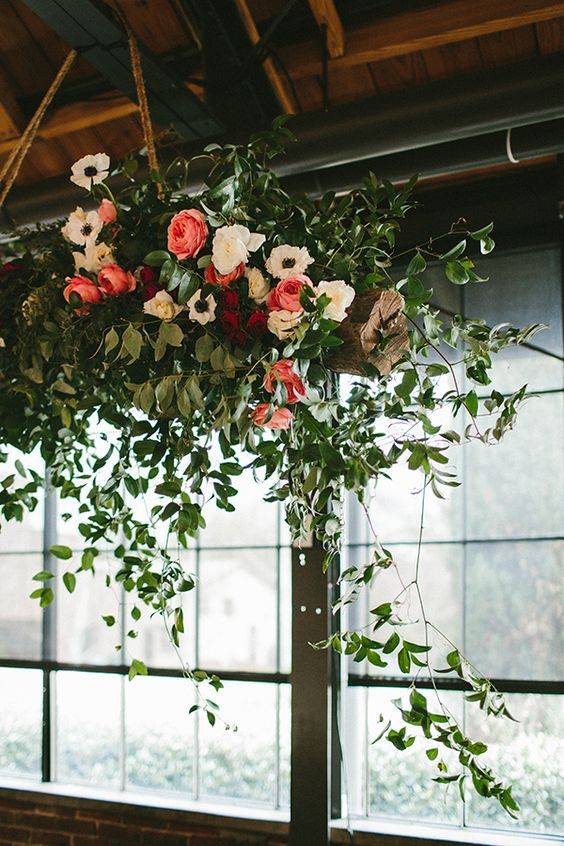 roses, anemones and greenery chandelier for a rustic wedding