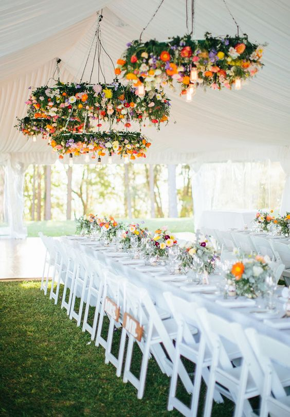 super bold flower chandeliers are amazing for a fall wedding reception, make several of them