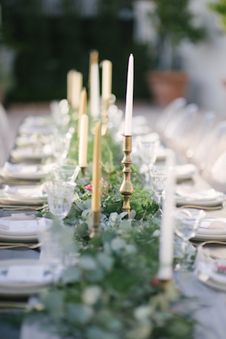 Scattered candles and greenery table runner | Lauren Carroll Photography