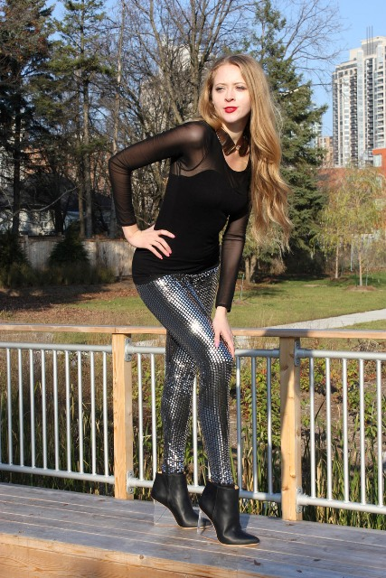 With metallic skinnies and black shirt