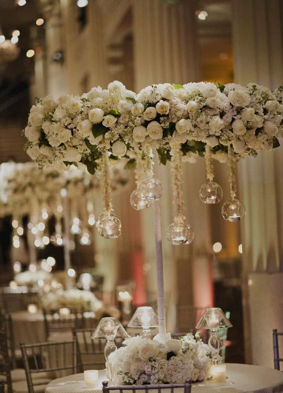 white rose hanging chandelier with spheres and candles inside them for a classic wedding