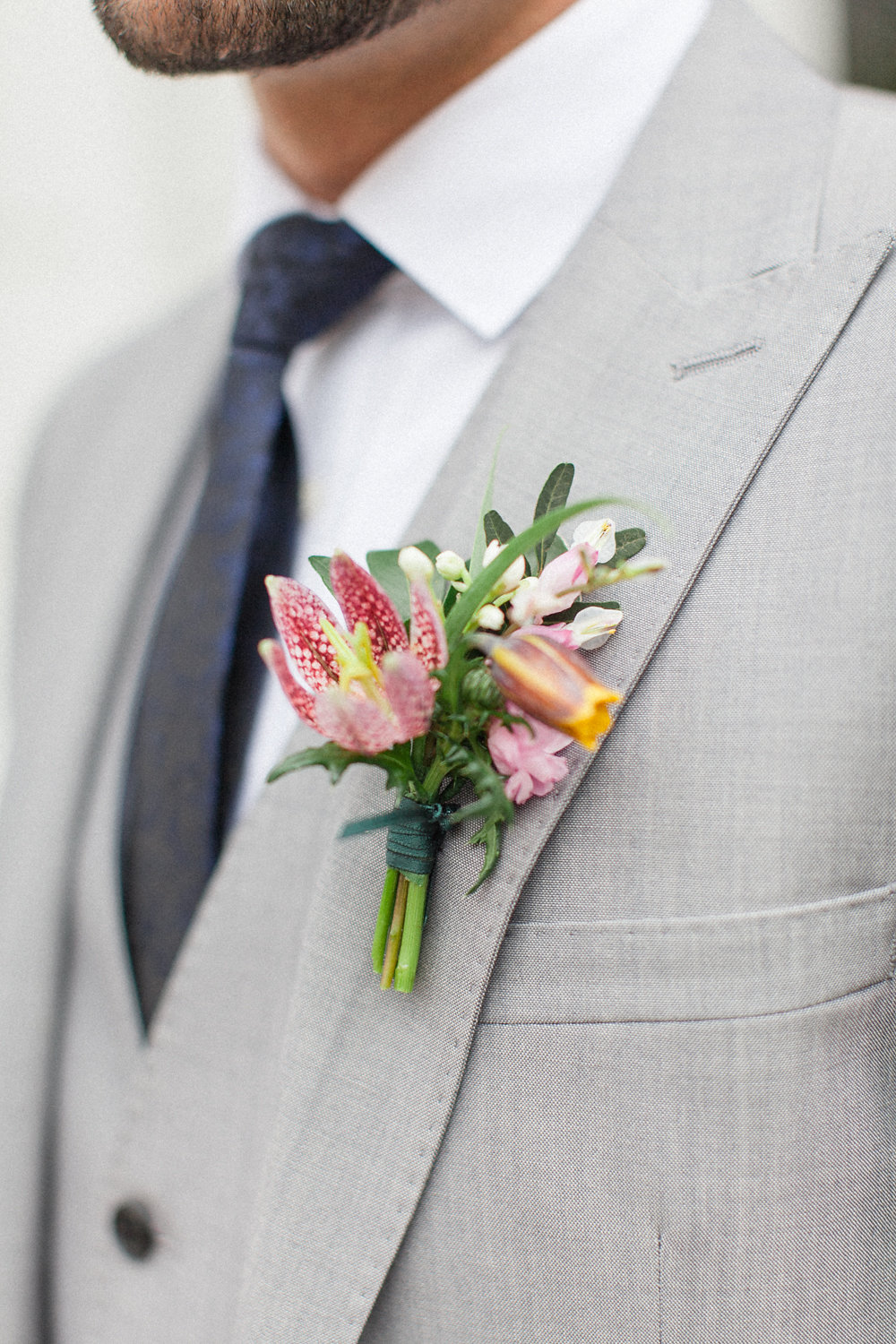 floral boutonniere - photo by Roberta Facchini Photography http://ruffledblog.com/herbarium-inspired-wedding-ideas