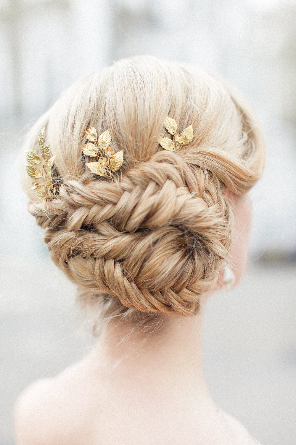 fishbraid bun wedding hair - photo by Roberta Facchini Photography http://ruffledblog.com/herbarium-inspired-wedding-ideas